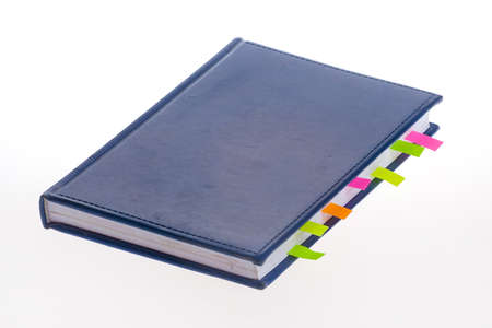 bookmarks: Dark blue notebook and bookmarks on the white background Stock Photo