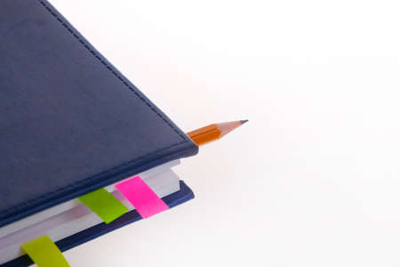bookmarks: Dark blue notebook, pencil and bookmarks on the white background