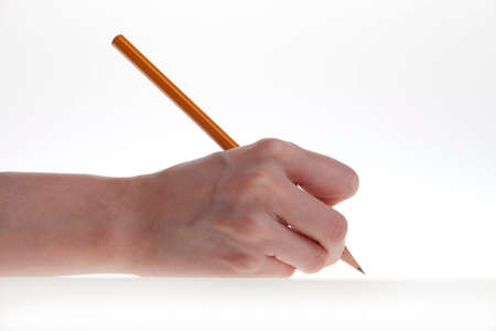 hand writing: womans hand and a pencil on a white background Stock Photo