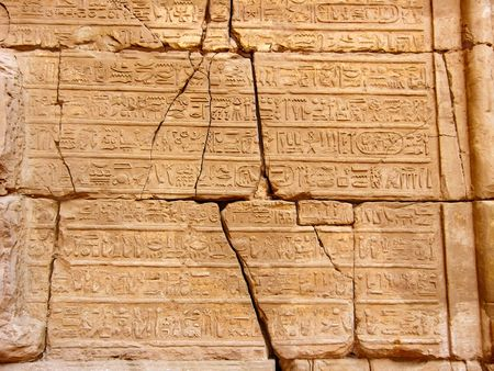 Hieroglyphics on antique wall in Karnak Temple. Luxor, Egypt. photo