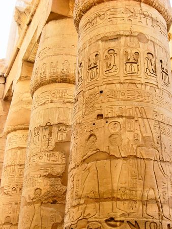Egyptian hieroglyphics and relieves on the stone column. photo