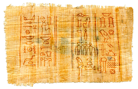 Ancient papyrus with Egyptian hieroglyphs: the names of the goddess of Isis (left) and the god of the Underworld of Osiris (right). Manuscript from The Karnak temple, Thebes valley, Luxor, Egypt. 스톡 콘텐츠