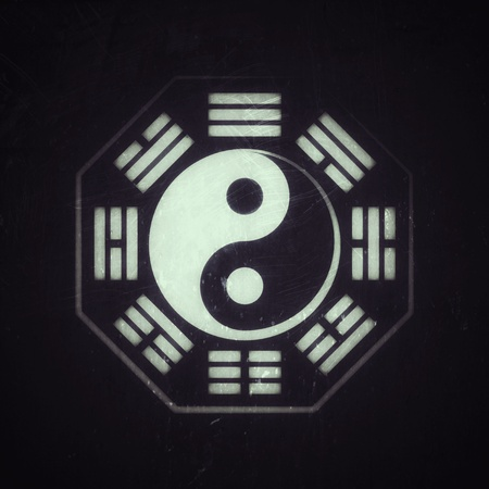 Yin-Yang and Bā-guà (8 trigrams). The Chinese Cosmic Symbol of duality and unity of opposites, surrounded by hieroglyphs of the eight essential elements of Nature. The Universal Principle of Harmony. (Alternate grunge vintage remake).