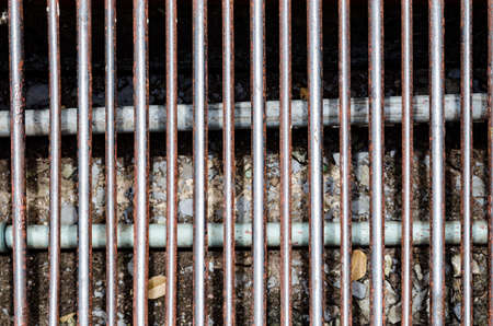 to grate: The grate of manhole cover on the roadside