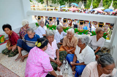 ordain: NAKHONRATCHASIMA, THAILAND - APRIL 27, 2013: Many elderly people sitting in groups discussing the ordination of Thailand.