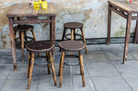 Classic wooden tables and chairs Using food as the restaurants old-fashioned Thailand.