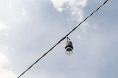 constitute: Lamps suspended on wires. Behind the sky