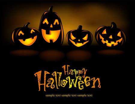 Happy laughing Halloween lanterns in the dark.