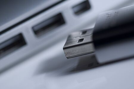 usb2: a USB stick in front of a USB port Stock Photo