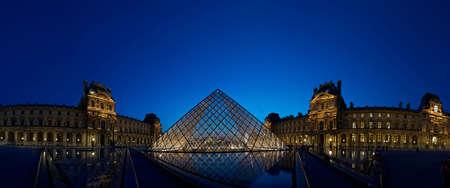 louvre pyramid: Panoramic Musee de Louvre Pyramid glowing at dusk, Paris Editorial