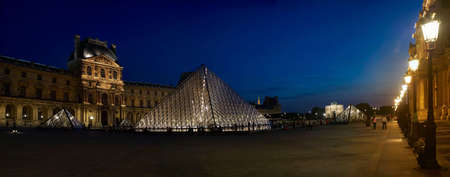 louvre pyramid: strolling down Musee de Louvre Pyramid at dusk, Paris