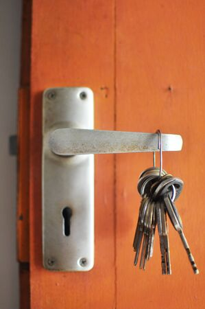 lock and hanging keys Stock Photo