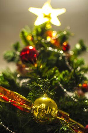 christmas tree ball: Golden Christmas Ball on tree