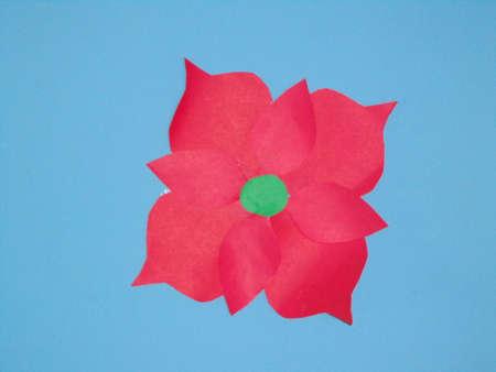 sublime: cartoon flower petal pink colored together pointy green fluorescent center pestal blue background.
