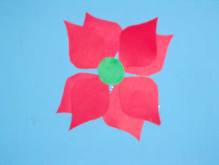 sublime: caricature of a flower petal green florescent center Together with reddish blue background Pink with much fragrance and beauty.