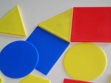 triangle shaped: geometric shapes circle square and triangle shaped yellow red blue colors useful for calculating diagonal perimeter and area.