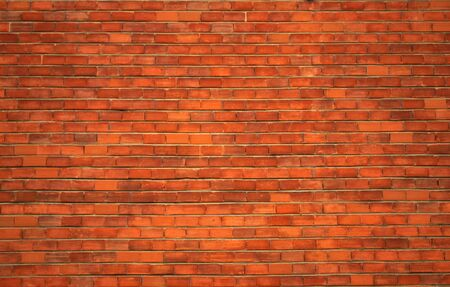 a red brick wall for backgrounds or wallpaper photo