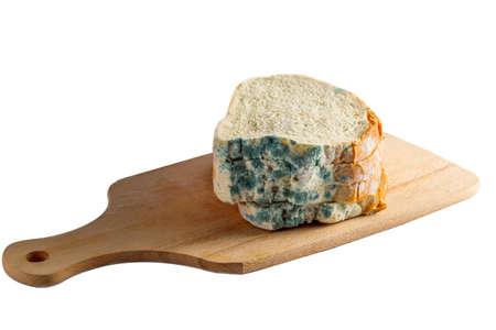 moldy: moldy bread on plank Stock Photo
