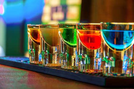 nightclub: Colorful shot drinks in nightclub in summer