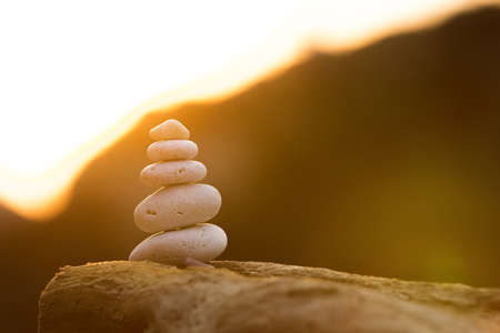 group objects: stones balance in sunset in beautiful summer day