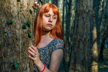 beautiful redhead: beautiful redhead girl in the forest Stock Photo