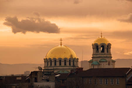 city landscape: dome of a church at sunrise in winter Stock Photo