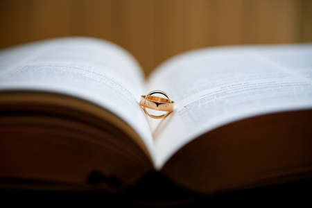 Wedding rings on a book Stock Photo