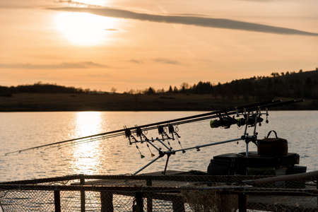 Fishing on the lake sunset in spring