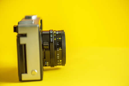 Very Old Vintage Film Camera, Studio Shot in yellow background.