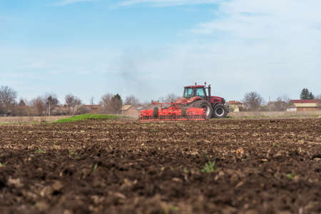 Tractor plowing fields. Preparing land for sowing in autumn. Stok Fotoğraf