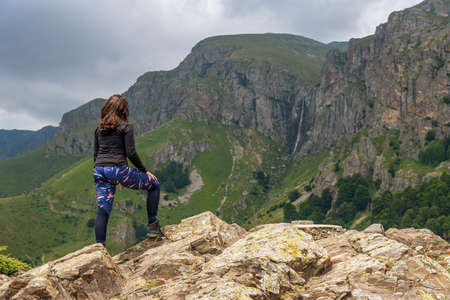 Lone active woman at the edge of the cliff, Central balkan, Bulgaria.