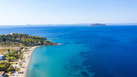 Aerial sunset view of amazing Neos Marmaras cityscape and distant turtle island in Greece. Banco de Imagens