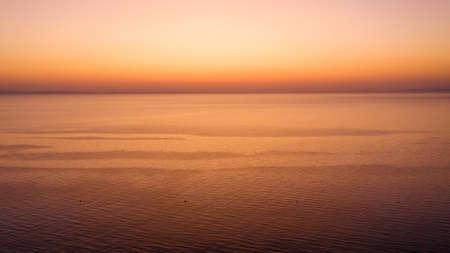 Waves at sunset at mediterranean sea.