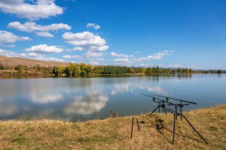 Fishing adventures, carp fishing. Is fishing with carpfishing technique. Camping on the shore of the lake. Banco de Imagens