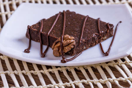 A slice of chocolate cake on table.