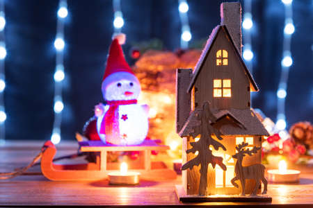 Christmas gingerbread house decoration on defocused lights