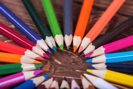 Colored multi colored pencils close up macro down on a vintage wooden 写真素材