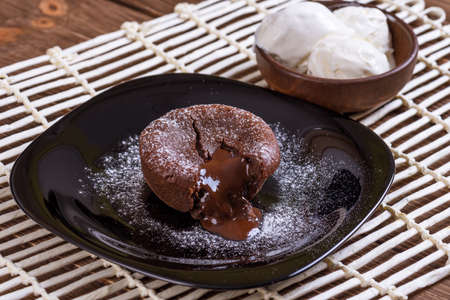 Plate with chocolate fondant and ice cream 写真素材