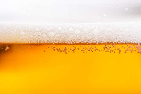 Light Beer with Bubbles and Foam Background. Beer Bubbles Texture Close Up.