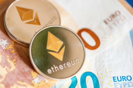Close-up of Ethereum coins on Euro banknotes. Crypto currency ETC.
