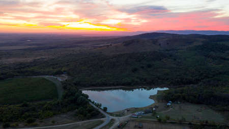 Magnificent autumn sunset over Bulgarian Lake in the Elenovo Village.Aerial view.