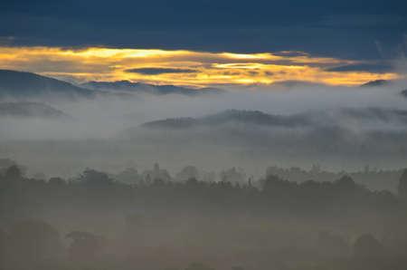 farther: fog mountain  Stock Photo