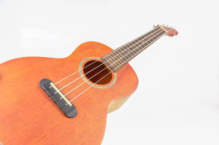 Brown ukulele, Hawaiian guitar, isolated on white background.