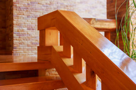 Modern style staircase with wooden steps and handrail.