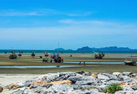 ship bow: Prajubkirikrun, Thailand-July 18,2016: Wooden fishing boat on a sandy beach