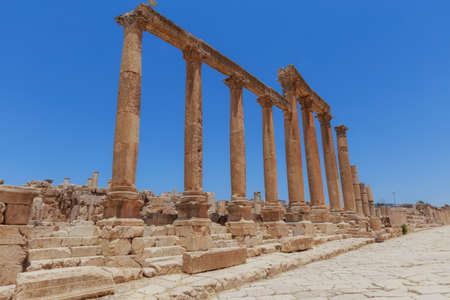 colonnaded: The ancient Roman city in Jerach, Jordan, Colonnaded Street, summer time, blue sky background.