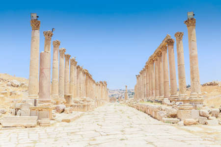 The ancient Roman city in Jerach, Jordan, Colonnaded Street, summer time, blue sky background.