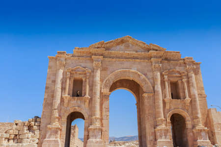 The ruins of Hadrain's Arch in Jerach, Jordan, summer time , blue sky background.