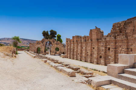 The ruins of Hadrain's Arch in Jerach, Jordan, summer time, blue sky background. Stock Photo