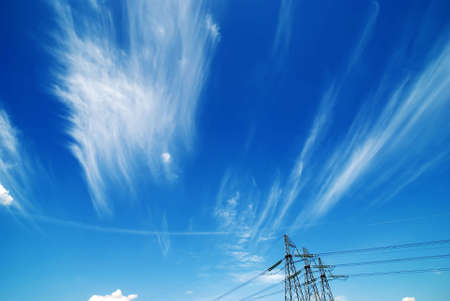 The electrical pylons against the background of the sky